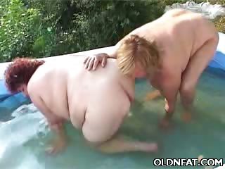 Porn Tube of Mature Bbws Frolicking In An Inflatable Pool