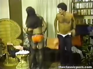 Porno Video of Retro Black Girl Between White Rods